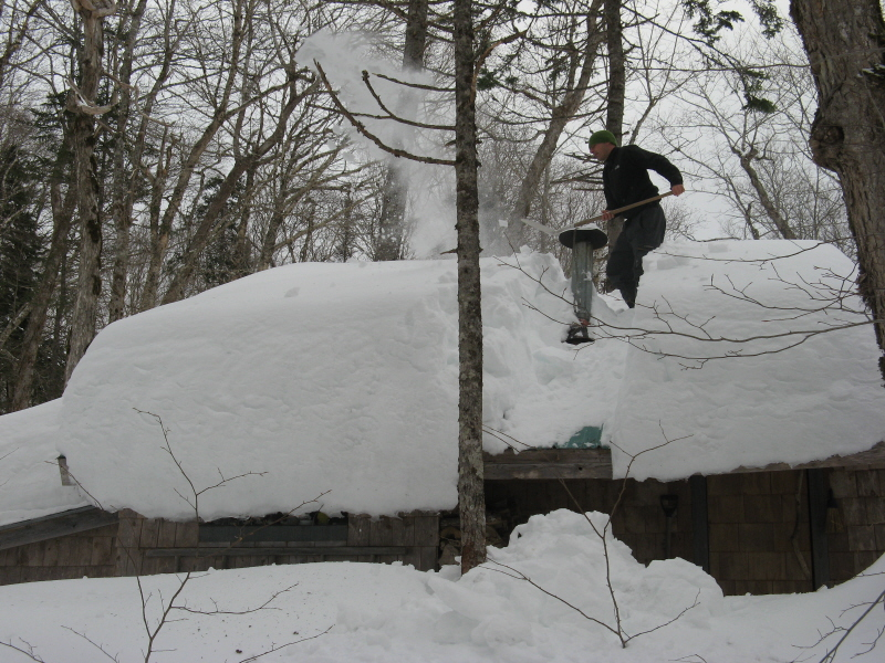 Angelo shovels off the Chalet Roof